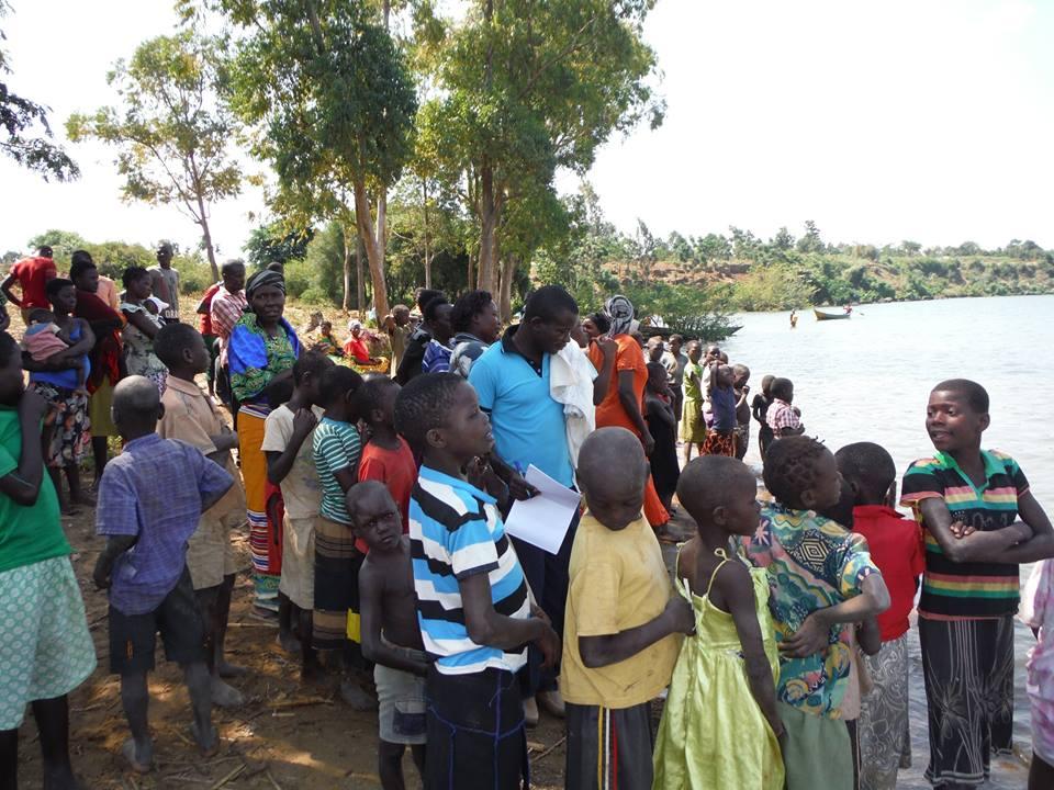people-observe-water-baptismin-progress